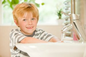 Boy washing hands - Plumbing, sewer, & drain services in Peoria IL