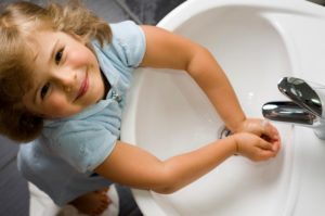 girl washing hands - Plumbing, sewer, & drain services in Peoria IL