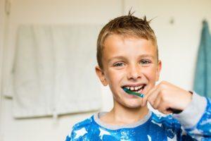 kid brushing teeth - Plumbing, sewer, & drain services in Peoria IL